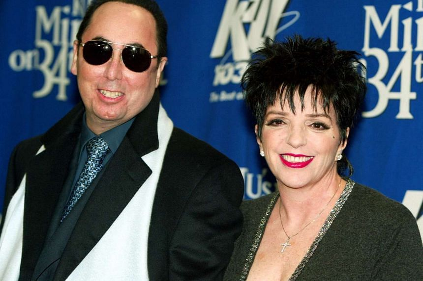 """Singer Liza Minnelli and her husband David Gest pose for photographers backstage of the """"Miracle on 34th Street"""" concert hosted by radio station WKTU in New York City, in this file photograph dated Dec 18, 2002."""
