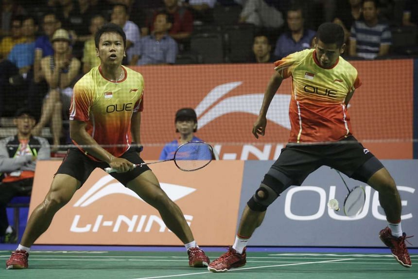 Singapore's Hendra Wijaya (right) and Danny Bawa Chrisnanta (left) during the  men's doubles first round of OUE Singapore Open on April 13, 2016.