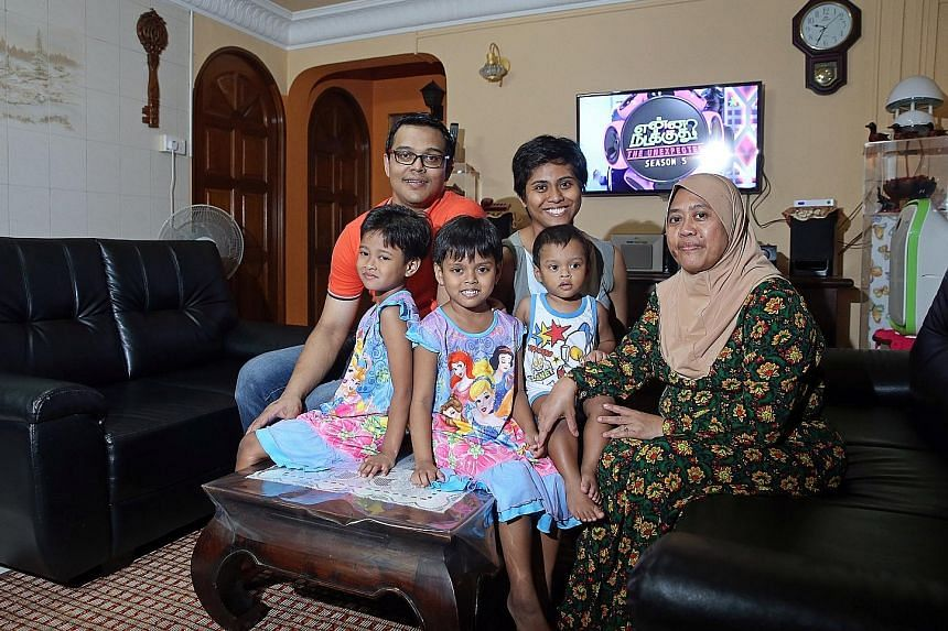 Mr Sathish and his fiancee Stella Shalini David John successfully applied for a Build-To-Order flat in Hougang last November, and received $60,000 in HDB grants. Madam Nur Liza and her husband Yulandi Abu Bakar with their children (from left) Nurul N