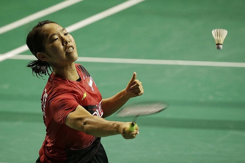 Singapore's Grace Chua saving a shot against Bulgaria's Petya Nedelcheva in the women's singles qualifiers at the OUE Singapore Open. Chua came through the qualifiers and will face Japan's Sayaka Sato in the opening round at the Singapore Indoor Stad