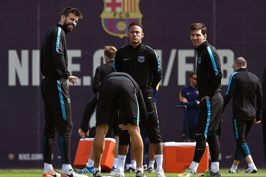 From left: Defender Gerard Pique with forwards Neymar and Lionel Messi during training on the eve of their Champions League quarter-final second leg at Atletico Madrid. Leaders Barcelona have lost their last two La Liga matches and drawn the third.