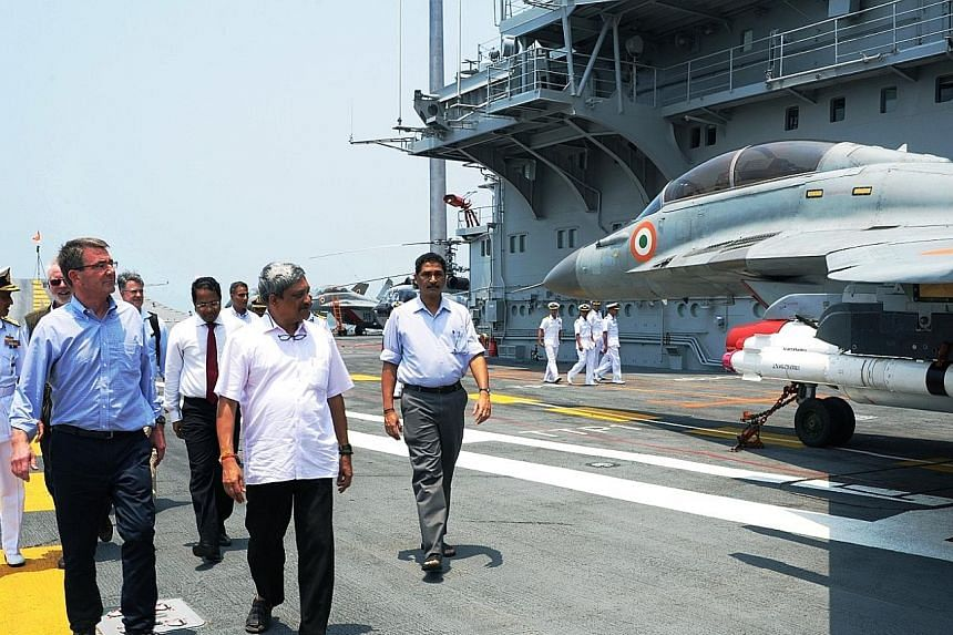 US Defence Secretary Ashton Carter (left) and Indian Defence Minister Manohar Parrikar (in short sleeves) touring the Indian Navy's flagship, INS Vikramaditya, in Mumbai. The US is seeking closer defence cooperation with India as concerns in the regi