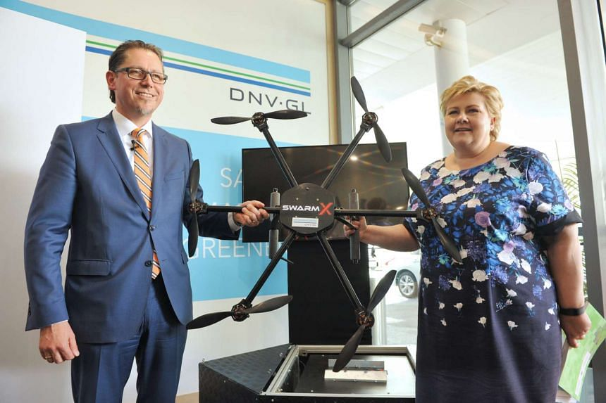 Norwegian Prime Minister, Erna Solberg (right) and Remi Eriksen (left), Group President and CEO of DNV GL, posing with a sample drone.
