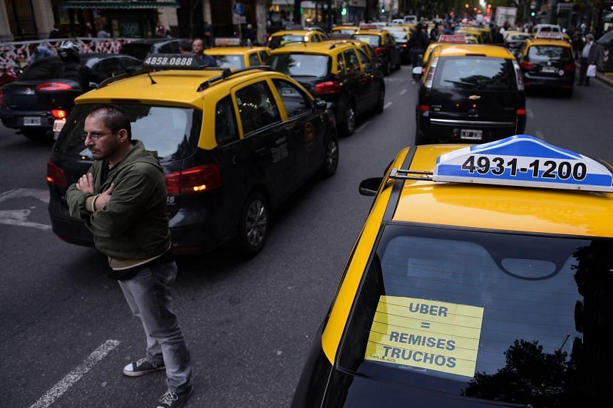 Taxi drivers blocking a road in Buenos Aires in protest against Uber on April 12.