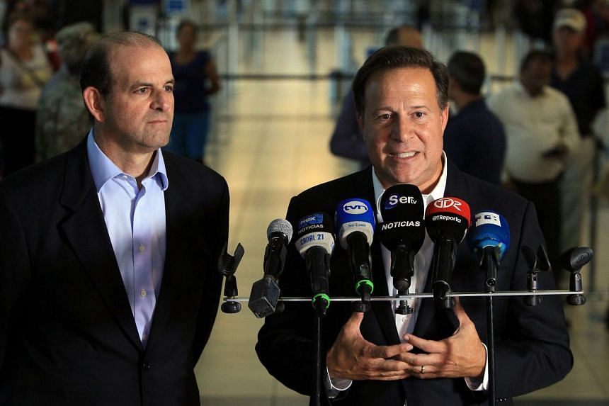 President of Panama Juan Carlos Varela (right) makes a statement after France's decision to include Panama on a blacklist of countries.