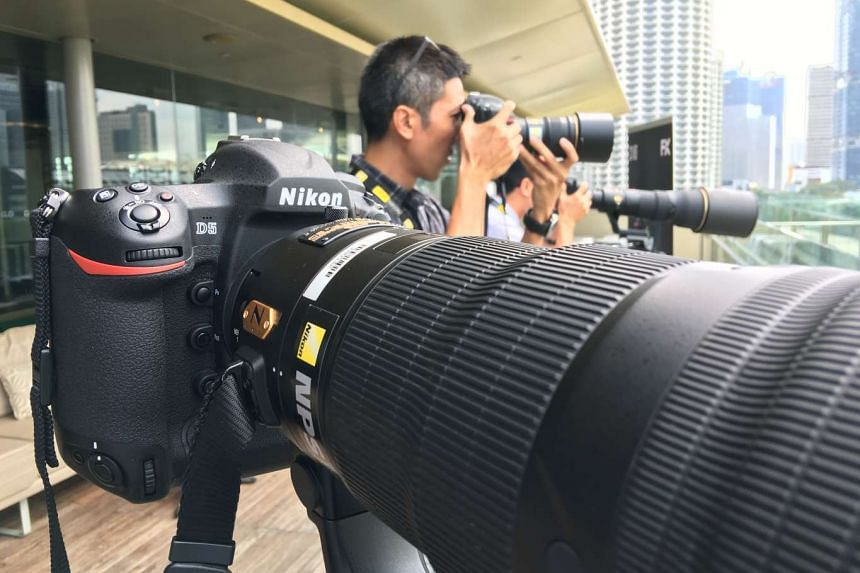 Members of the press trying out the Nikon D5 (front) during the media launch at the National Gallery Singapore.