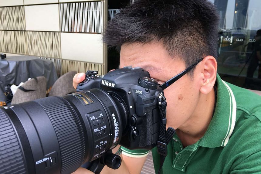 A member of the press trying out the Nikon D500 during the media launch at the National Gallery Singapore.