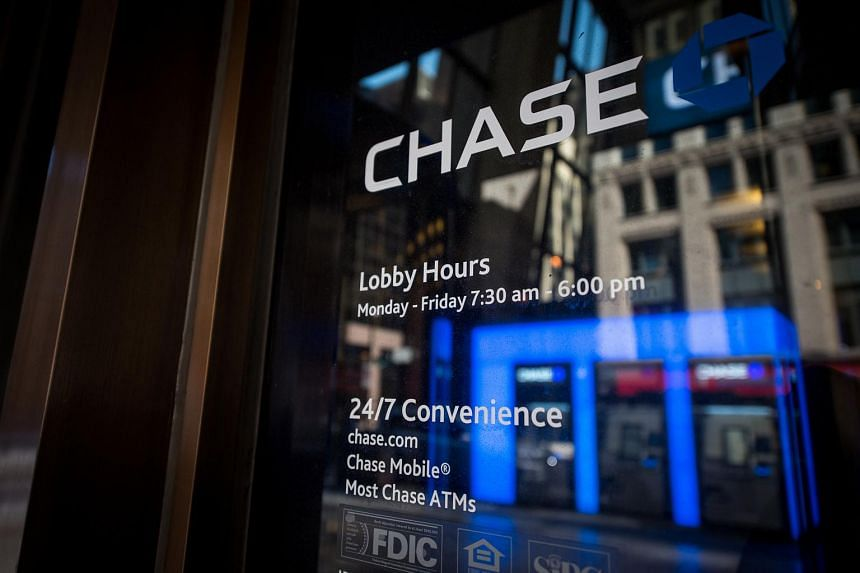 Signage is displayed at a JPMorgan Chase & Co. bank branch in Chicago.
