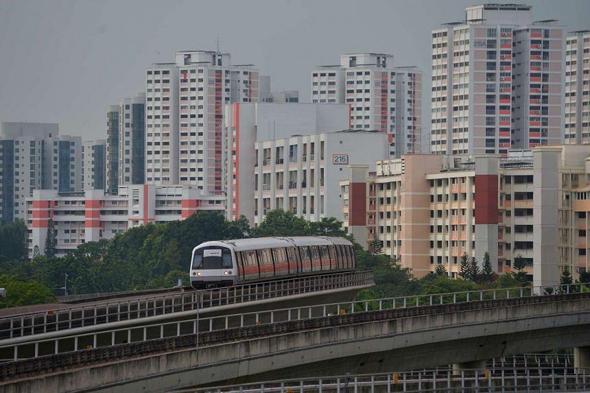 A MRT train moving towards Jurong East MRT station.