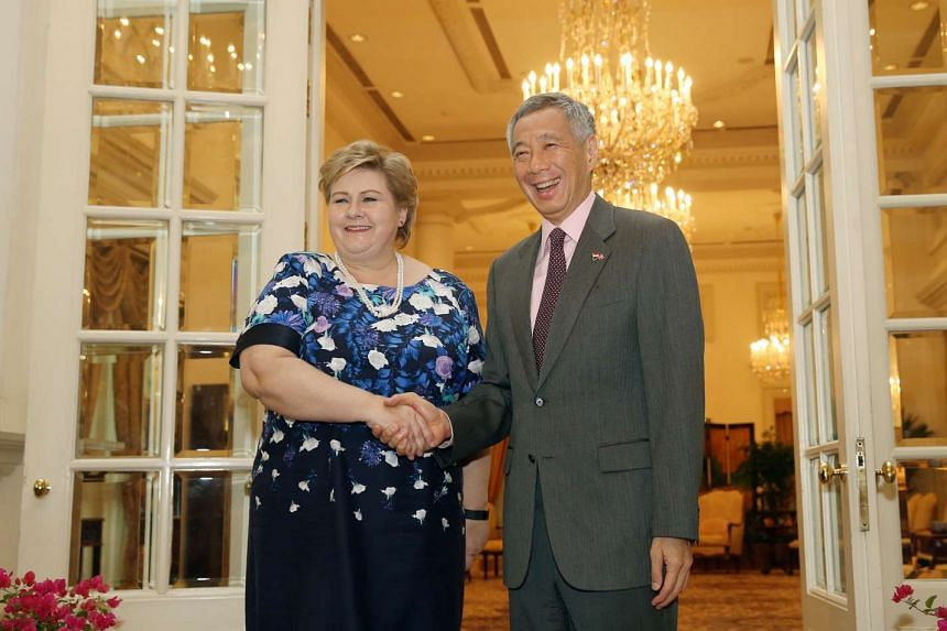 Norwegian Prime Minister Erna Solberg (left) shaking hands with Singapore PM Lee Hsien Loong at the Istana on April 13, 2016.
