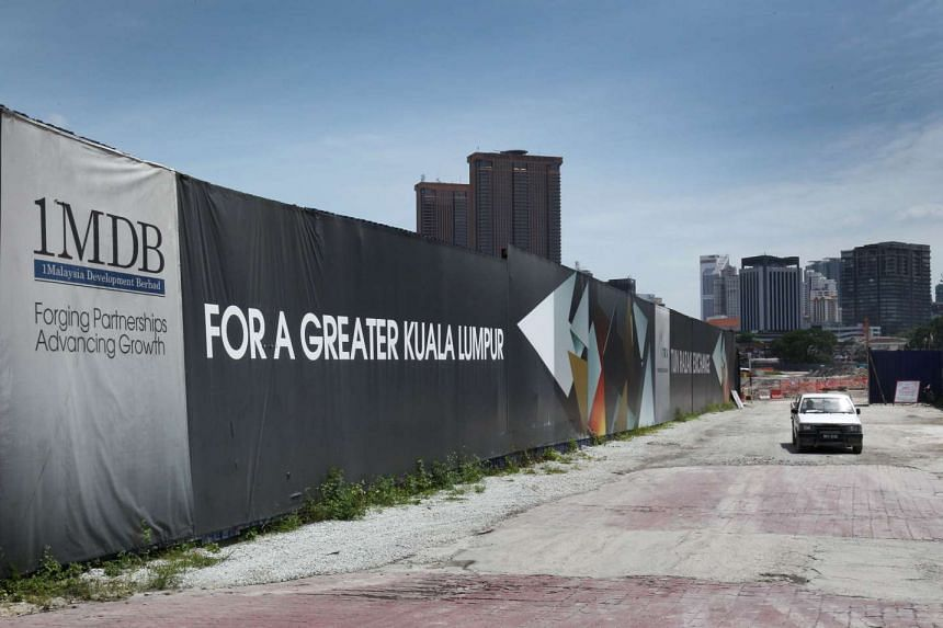 The signage for 1Malaysia Development Bhd (1MDB) displayed at the site of the Tun Razak Exchange financial district in Kuala Lumpur.
