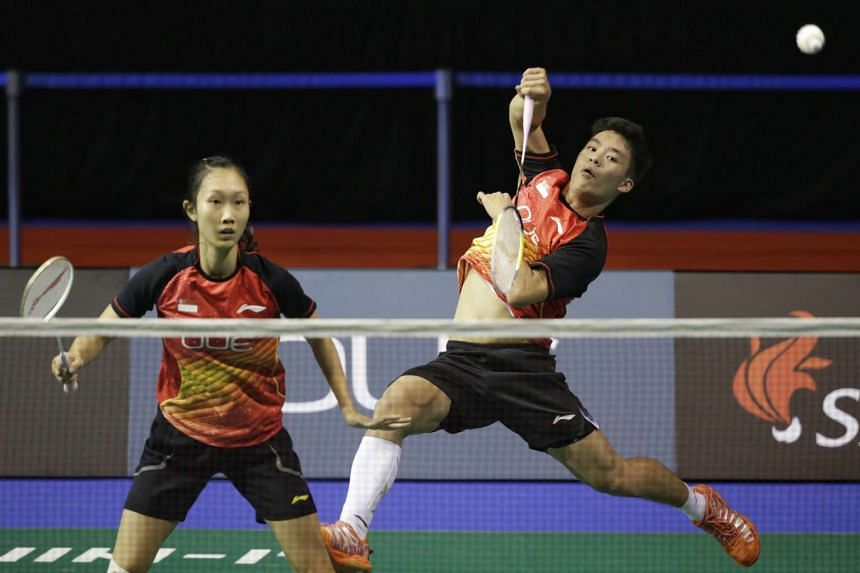 Singapore's Tan Wei Han (left) and Terry Hee Yong Kai returning a shot against Korea's Choi Solgyu and Won Eom Hye in the mixed doubles qualifiers of OUE Singapore Open at the Singapore Indoor Stadium on April 12, 2016.