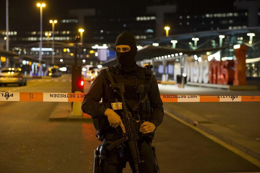 Heavily armed members of the Dutch Marshals stand guard at Schiphol Airport in Amsterdam, The Netherlands, on April 13, 2016.