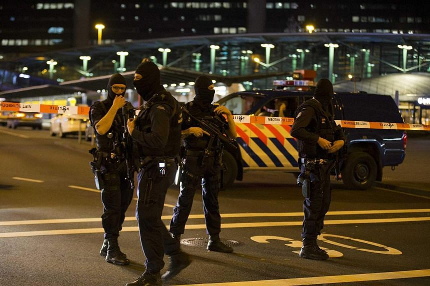 Heavily armed members of the Dutch Marechaussee seen at Schiphol Airport in Amsterdam on April 12, 2016.