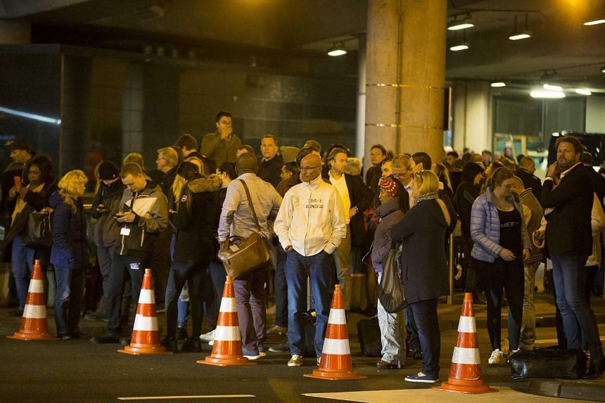 Travellers waiting at Schiphol Airport in Amsterdam on April 12 2016, after a section of the airport was evacuated.