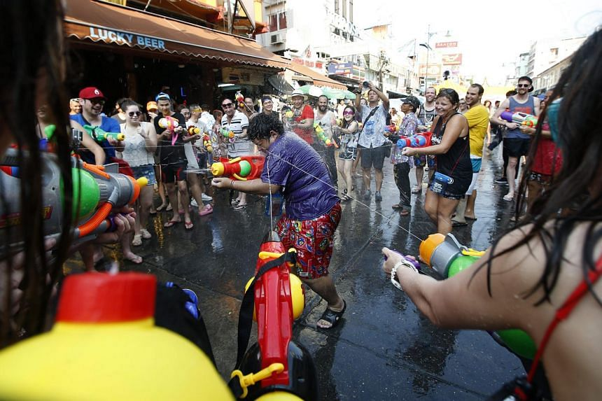 Tourists spraying each other with water on the popular tourist strip of Khao San Road, during the Songkran Festival celebration in Bangkok, Thailand, on April 12, 2016.