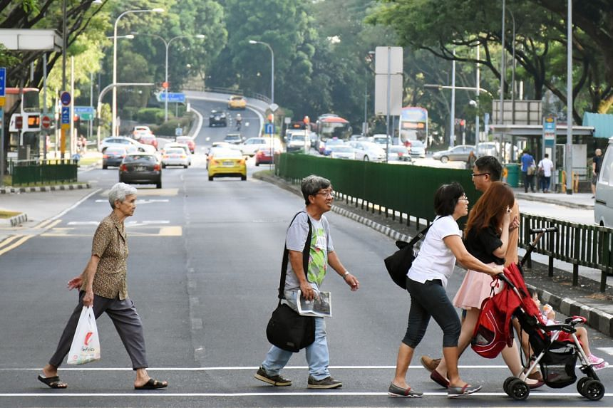 Signalised pedestrian crossings make it easier for the elderly and those with disabilities to cross the road because they are less physically taxing compared to overhead bridges or underpasses, said Senior Minister of State for Transport Josephine Te