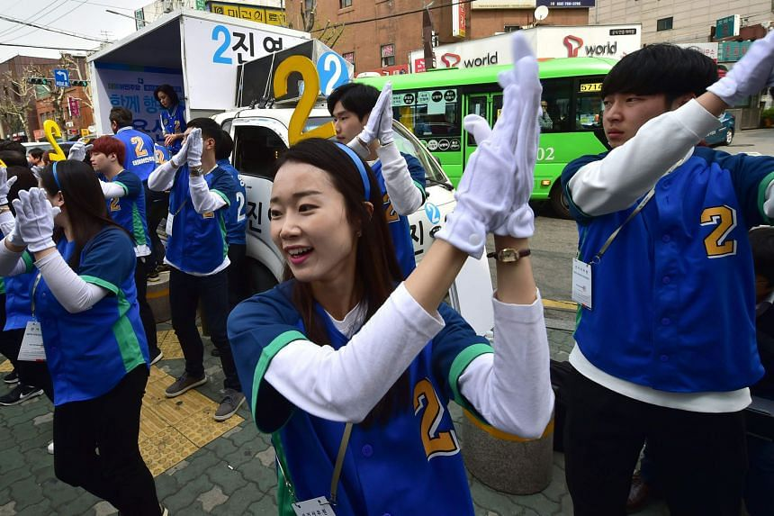 Supporters of South Korea's main opposition Minjoo Party rallying support during an election campaign yesterday.