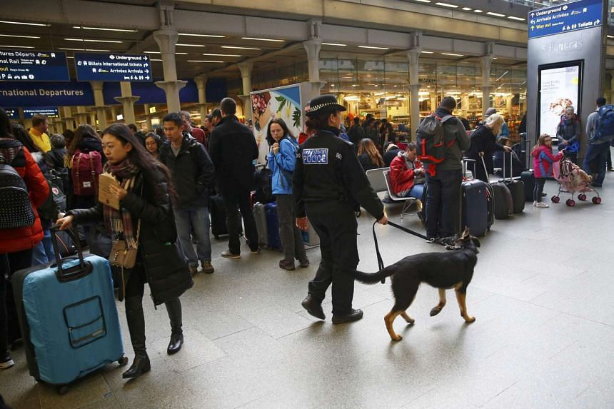 A police dog handler at St Pancras station in central London, Britain on March 22, 2016.