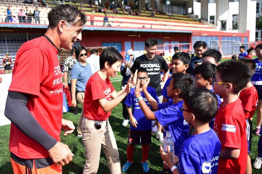 (From left) Aleksandar Duric and Minister for Culture, Community and Youth, Grace Fu, giving encouragement to participants at the launch of the ActiveSG Football Academy.