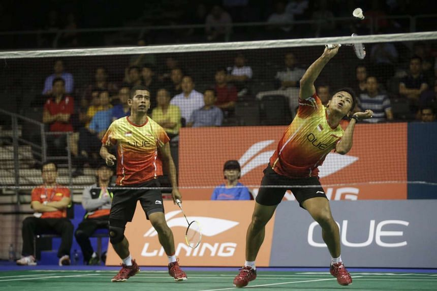 Singapore's Hendra Wijaya (left) and Danny Bawa Chrisnanta (right) in action during the first round of the men's doubles of the OUE Singapore Open.