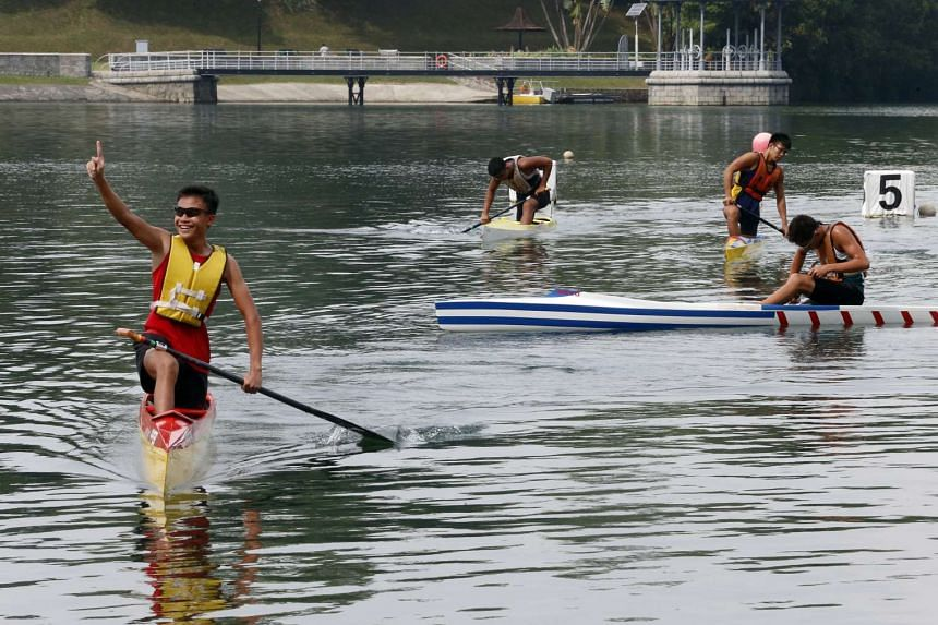 Hwa Chong Institution's Tay Lng Jaey celebrating after his team wong the B-Boys C1 - 1000m in the Schools Canoeing National Championships 2016.