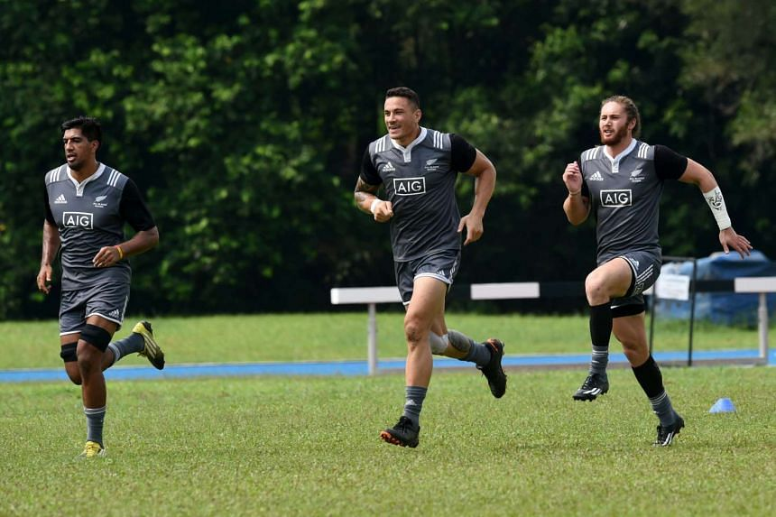 New Zealand All Blacks' Sonny Bill Williams (centre), Liam Messam (left) and Gillies Kaka during a training session ahead of the Singapore Sevens rugby tournament on April 14, 2016.