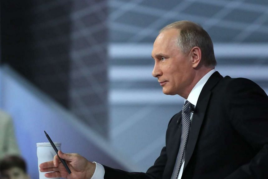 Russian President Vladimir Putin attends an annual Question and Answer live-broadcast nationwide television and radio session in Moscow on April 14, 2016.