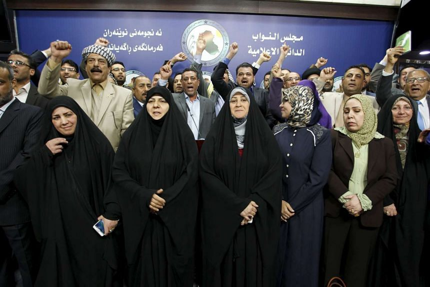 Members of parliament who held a sit-in, shout slogans during a news conference at the parliament building in Baghdad, Iraq, on April 14, 2016.