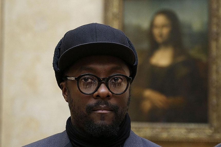 Black Eyed Peas frontman will.i.am (above) in front of the Mona Lisa painting by Italian artist Leonardo da Vinci at the Louvre museum on Tuesday.