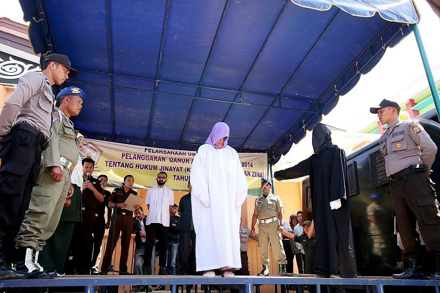 The Christian woman being caned nearly 30 times in front of a crowd - the first non-Muslim to be punished in Aceh under strict religious laws.