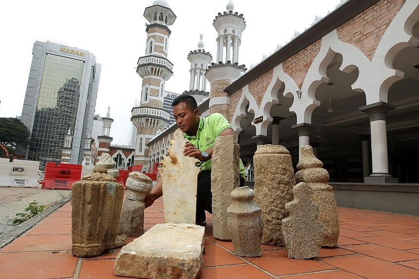 The gravestones unearthed near Jamek Mosque (left) are made of granite, marble and sandstone (right). Workers have now been alerted to look out for more artefacts