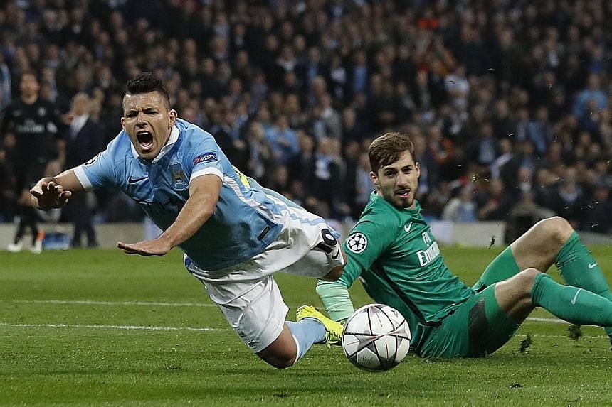 Manchester City's Sergio Aguero is brought down in the area by PSG's Kevin Trapp. The Argentinian striker missed the resultant penalty but City still went on to win 1-0 on the night to reach the semi-finals.