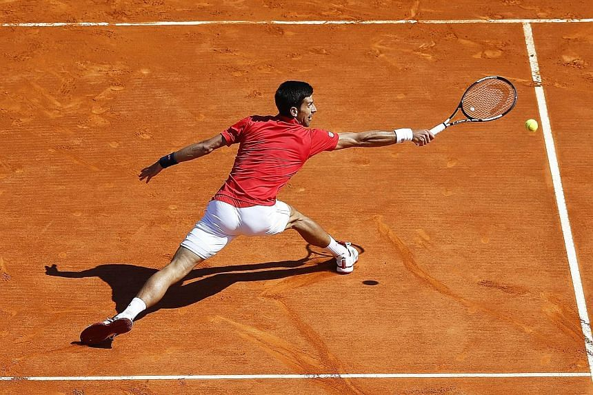 Novak Djokovic stretches to return to Jiri Vesely during their Monte Carlo Masters second-round match. This is only the second time this year that the Serb has not left a tennis court with a victory, after retiring due to illness in Dubai in February