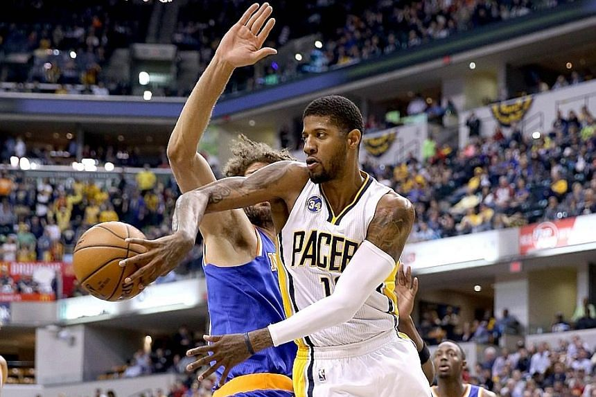 Paul George of the Indiana Pacers passes the ball during his team's 102-90 win over the New York Knicks at the Bankers Life Fieldhouse in Indianapolis. The Pacers will face the Toronto Raptors in the first round of the Eastern Conference play-offs.