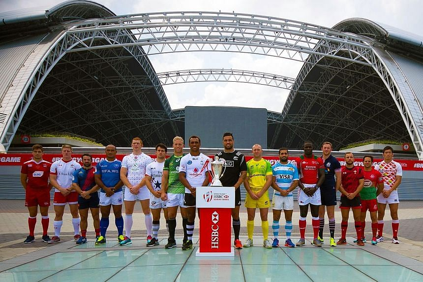 The captains of the 16 competing teams posing with the Singapore Sevens trophy. Fiji lead the standings, followed closely by New Zealand and South Africa, with Australia fourth.