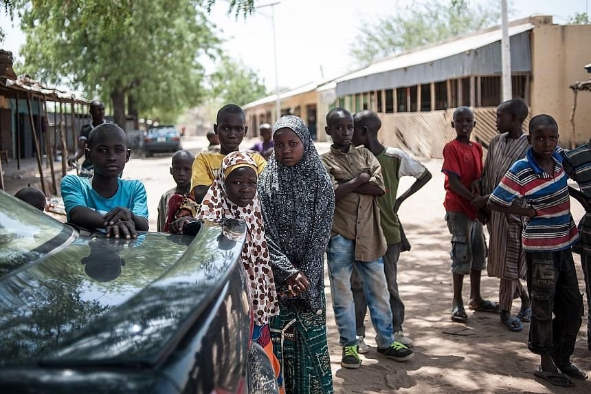 Children in Chibok, Nigeria. In the past two years, one in five suicide bombers deployed by Boko Haram has been a child and the youngest bomber so far was thought to have been eight years old.