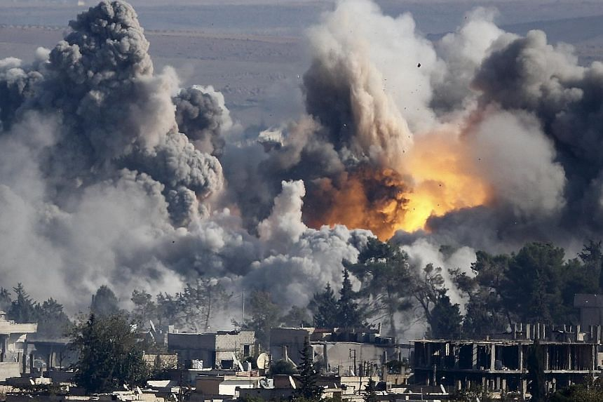 Smoke rising over the Syrian town of Kobani after an air strike in October 2014. The Islamic State in Iraq and Syria has lost cities and towns since it seized Ramadi, Iraq, almost a year ago.