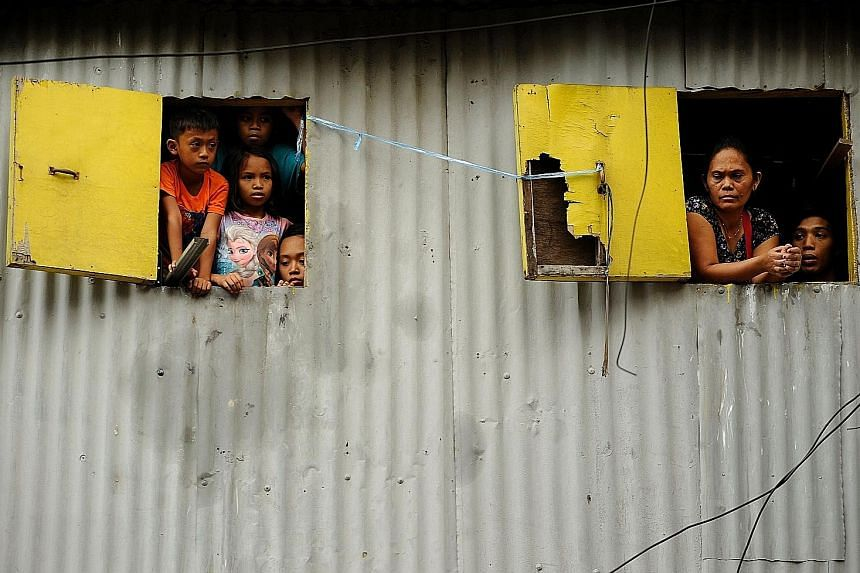 Residents of a shanty town in Manila. An ADB report says focusing on social inclusion and environmental sustainability will help Asian economies become more resilient to shocks and aid their long-term growth.