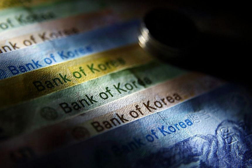 South Korean won banknotes are arranged for a photograph in Seoul.