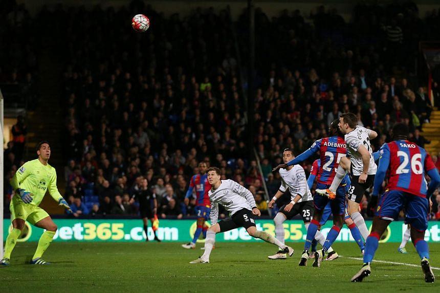 Crystal Palace's Emmanuel Adebayor misses a chance to score.