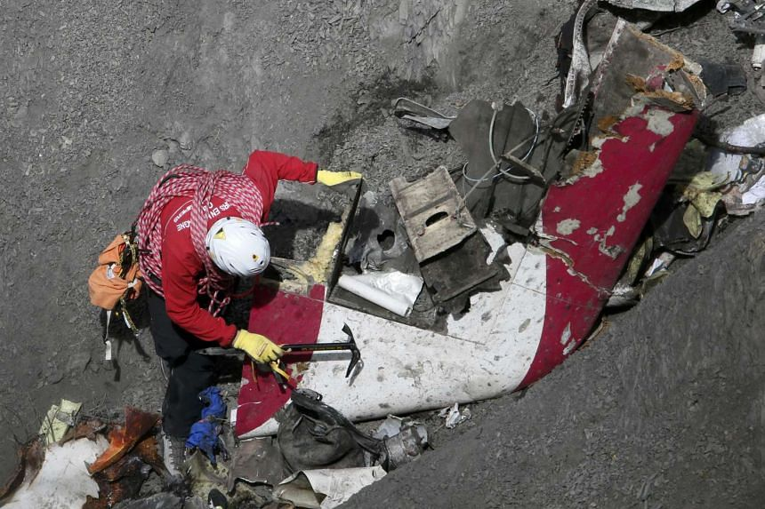 A French rescue worker inspects the debris of the Germanwings Airbus A320 at the site of the crash, near Seyne-les-Alpes, France, in this picture taken on March 29, 2015. Relatives of victims of the crash are suing the pilot's US flight school.