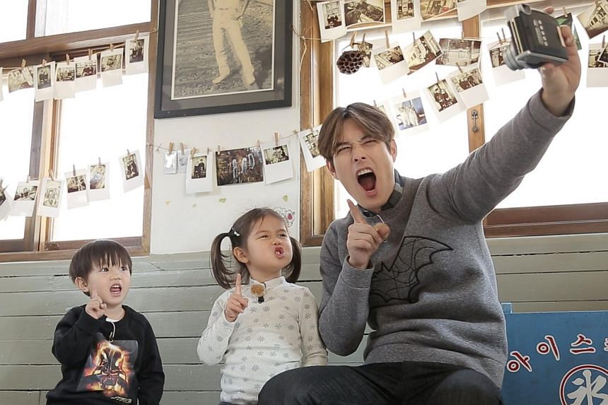 From left: Stars of parenting reality show Kim Tae Oh, Kim Tae Rin and their actor daddy, Ricky Kim.