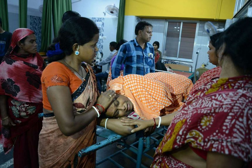 Indian resident Lucy Singh Biswas is comforted by relatives at Siliguri Hospital after she broke her leg by falling down stairs when tremors hit Siliguri on April 13. Myanmar was struck by a magnitude 6.9 quake, the US Geological Survey reported.