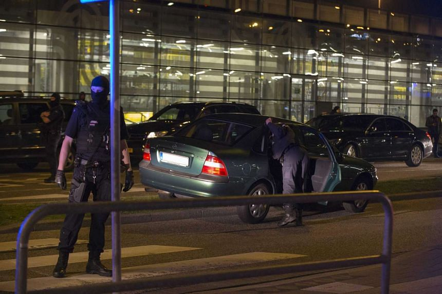 Members of the Dutch marshals check a car with a Belgian licence plate at Schiphol Airport in Amsterdam, The Netherlands on April 12, after a homeless Pole was arrested for claiming to be a terrorist.