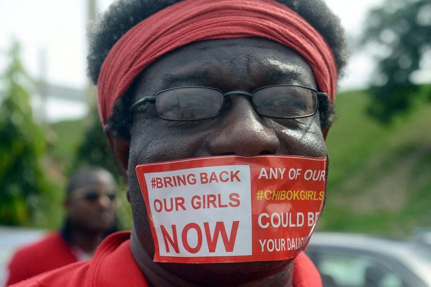 """A man with a sticker reading """"Bring Back Our Girls Now"""" on his mouth campaigning for the release of the kidnapped Chibok schoolgirls during a rally in the Nigerian capital Abuja."""