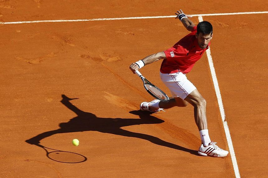 Serbia's Novak Djokovic returns a backhand to Czech Republic's Jiri Vesely, on April 13, 2016 in Monaco.
