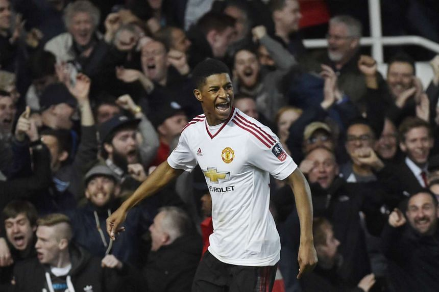 Marcus Rashford celebrates after scoring the first goal for Manchester United.