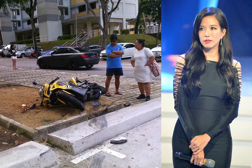 Rui En (far left) in front of the black BMW. In the foreground is the motorcycle that was knocked over.