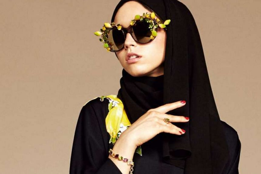 France's minister for women's rights Laurence Rossignol sparked outrage over her remarks on Muslim women who choose to wear conservative outfits. (Above) The current trend by Western designers like Dolce & Gabbana to cater to Muslim-style attire is an exp